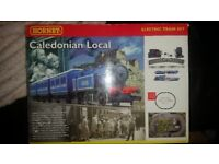 Hornby Caledonian Local electric train set 00 gauge R1016, brand new in box never used .