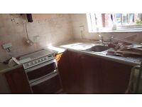 Cooker and kitchen