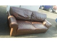 three seater leather sofabed. delivery.