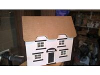 Cream dolls house with thatch effect roof