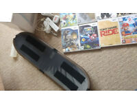Wii console and 25 games including skateboard