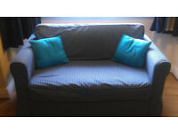 Ikea sofabed in smart Navy/white check. Hardly used. £80