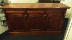 Side bord hand made solid mahogany with 3 draw's & 3 cupboards