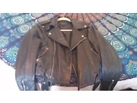 Biker style black leather jacket