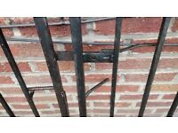 Two pairs of matching used double wrought iron gates.