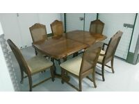 walnut dining room table with 6 chairs
