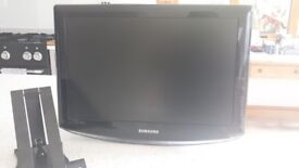 Samsung TV with Sky box remotes cables and wall bracket