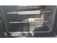 Zanussi Gas Cooker - nearly new, hob unused. ZCG6333OXA Top of the range cooker, energy efficient.