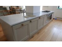 Complete kitchen with Corian worktop, units, gas hob and pan draws by Magnet