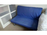 Two-seater sofa bed in very good condition
