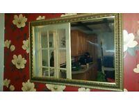 Gold effect edged large wall mirror
