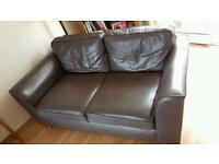 Brown leather three seater Marks & Spencer sofa