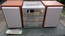 SANYO MUSIC SYSTEM JCX-X5. CD. CASSETTE. RADIO. WITH SPEAKERS. REMOTE CONTROL