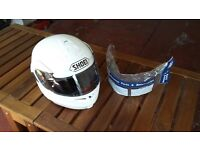 White SHOEL MULTITEC Crash HELMET.
