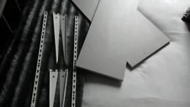 2 grey shelves 4 white shelf brackets and 2 white wall brackets