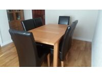 Oak dining table with 6 chairs for sale