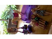 Barbie bundle including horse, swimming pool, rollerskating barbie and other dolls