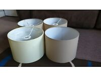 3 mink coloured lampshades and one cream. Also matching tall mink lamp.