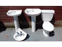 2 sinks with pedestals , 1 corner sink