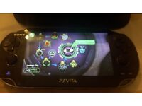 PS VITA 4 GAMES AND MEMORY CARD AND POUCH WITH ORIGINAL CHARGING CABLE