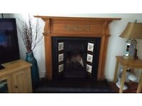 Victorian cast iron fireplace with wooden surround. Inset with original tiles, gas fire with coals
