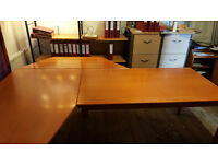 3 interlocking IKEA office tables in cherry finish