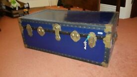 Immaculate blue travel chest, brass plated hinges and locks, with key. Leather handles. Many uses