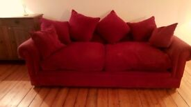 Large burgandy sofa, chair and matching rug for sale.
