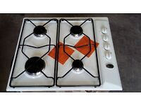 Whirlpool 4 ring Gas hob in white with electronic ignition.