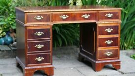 Lrather topped writing desk and Padded swivel chair.
