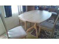 Small oval Table and three Chairs Good Condition