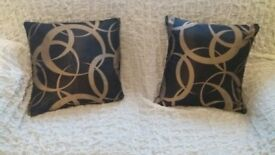 2 black/gold cushion covers size 18x18