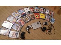 **slimline Sony PlayStation 2 in silver BUNDLE **