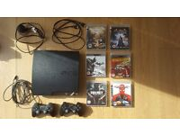 Playstation 3 Slim 160gb + 7 games + 2 Official Playstation Controllers