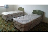 2 single divan beds with storage drawers and head boards