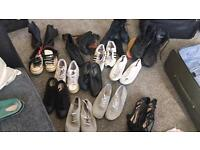 Various shoes boots and trainers