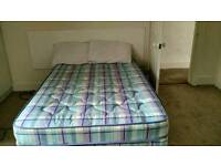 Double bed, mattress and 2 pillows. Price negotiable