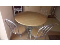 Bistro style round dining table with 4 chairs £25