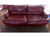 Very well used brown leather sofa bed and armchair. This was from dfs 12 years ago.