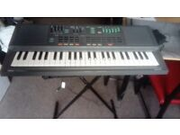 yamaha keyboard portasound PSS 460 with stand and case all working mybe old but still fun