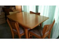 Genuine 1960's extending dining table and 4 chairs with matching sideboard
