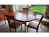 Teak extending dining table with six chairs, matching display cabinet or dresser