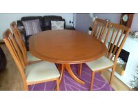 Morris of Glasgow. Teak dining table and 4 matching chairs. Circular or extendable