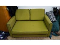 Lime green sofa bed. Heavy duty, suitable for every day use. Washable covers.