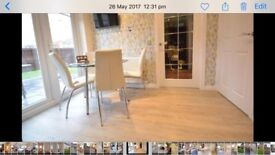 Ikea Dinign Table 1.1m diameter & 4 x White Leahter Chairs from Next