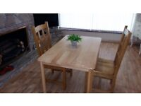 Pine table and 2 very solid chairs . Delivery can be arranged if required.