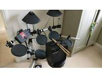 Yamaha DTXPLORER electronic drum kit. Amp and sticks included.