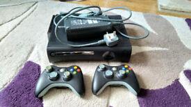 Xbox 360 + 2 wireless controllers, VGA cable, 250GB Hard Drive + wifi adapter