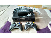 Xbox 360 + 2 wireless controllers, VGA cable, 250GB Hard Drive + wifi adapter