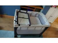 Travel cot with bassinet level and changing table
